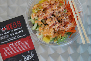 closeup of poke bowl beside Poke88 flyer
