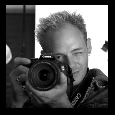 headshot of man holding camera