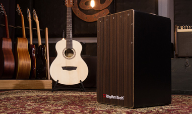 Rhythm tech cajon with multiple guitars in background