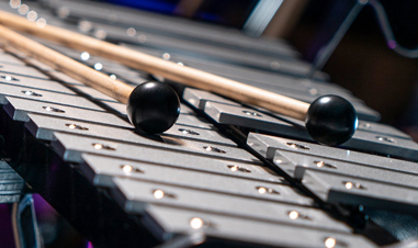 sticks lying on xylophone