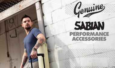 man leaning against wall with with Sabian symbols case in Sabian advertisement