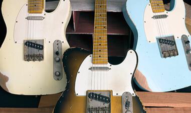 three Michael Kelly electric guitars