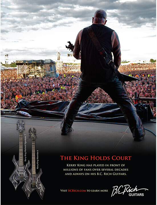 back view of man playing electric guitar on stage in front of large crowd in BC Rich Guitars print advertisement