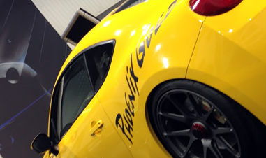 partial view of yellow sports car